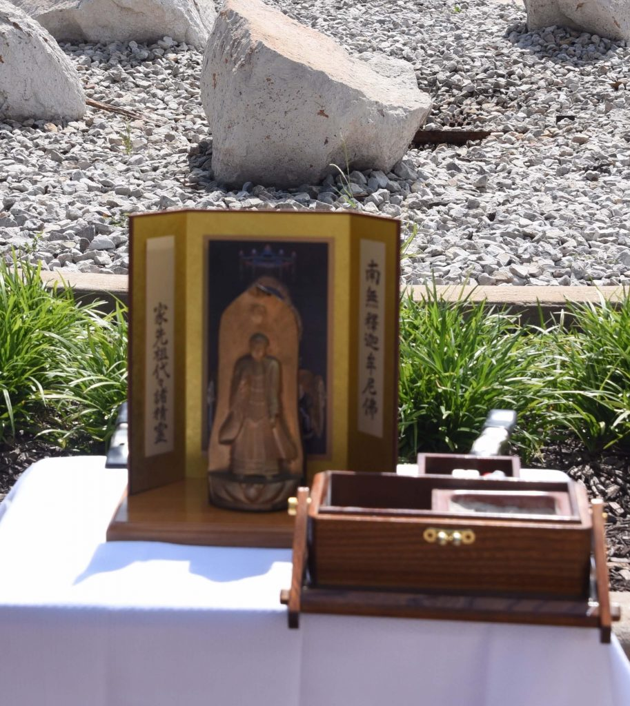 Photo of Buddha carved in Manzanar WRA Camp in 1943, for Rev. Duncan Ryuken Williams' ceremony