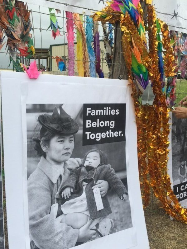 "Poster of WWII era mother and child set in front of Dilley prison fence. Poster text reads: ""Families belong together"""