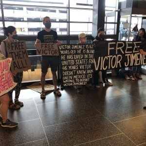 TFS protesters and La Resistencia stand at Sea Tac airport to protest and block the deportation of Victor Jimenez