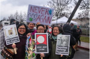 Over 500 people braved sheeting rain, gusting winds, and frigid temperatures to show up for Day of Remembrance, Day of Action at the Northwest Detention Center, February 2020. Photo: Ryan Kozu