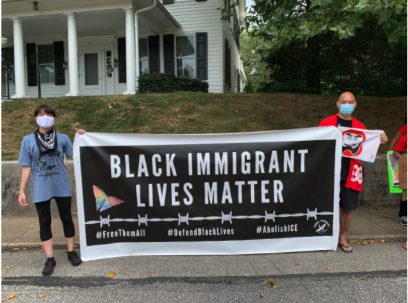 Tsuru for Solidarity members staged a die-in and healing ceremony outside of Governor Tom Wolf's home in Pennsylvania to call attention to the suffering of the families held in detention at Berks. Photo: Emily Akpan
