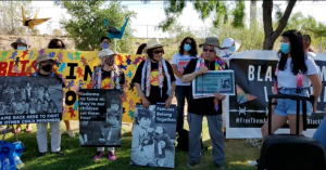 A photo of Gail Nanbu, Chizu Omori, Nikki Louis, and Paul Tomita sharing their statements at the Fort Bliss direct action. Photo Credit: Pressenza, captured from Facebook Livestream.