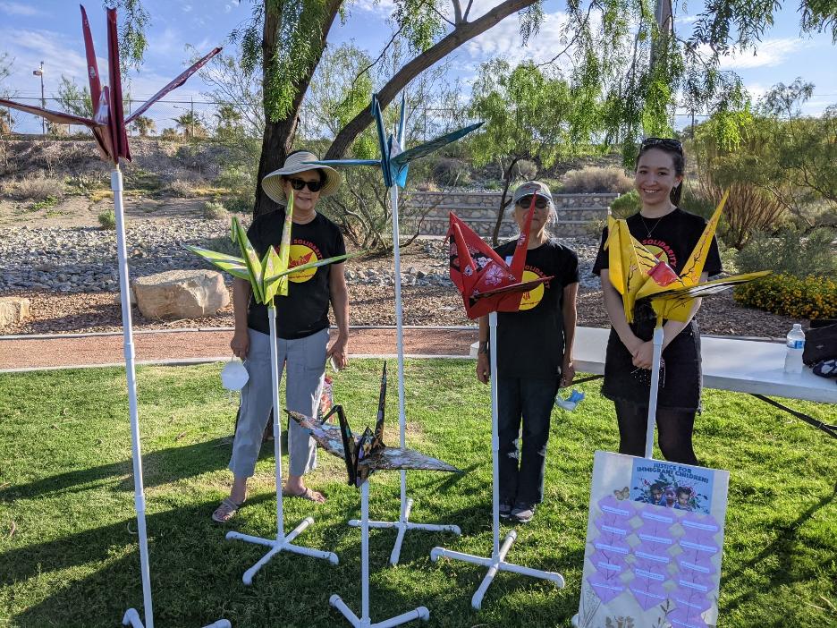 A photo of Mari Matsumoto, Emiko Omori, and Erica Kanesaka with the Tsuru Committee's beautiful flock of cranes. Photo Credit: Shoshana Arai.