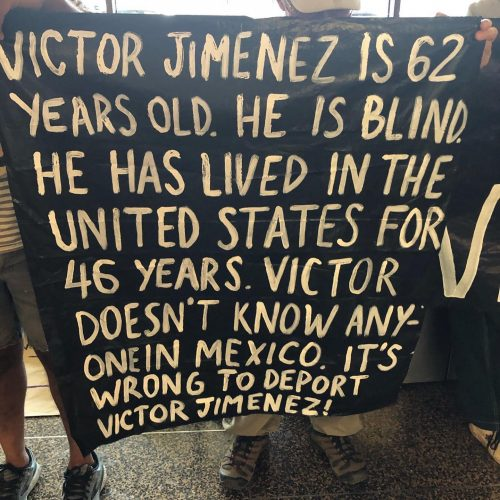 """Protest sign at Sea Tac airport reading: """"Victor Jimenez is 62 years old. He is Blind. He has lived in the United States for 46 years. Victor Doesn't know anyone in Mexico. It's wrong to deport Victor Jimenez."""